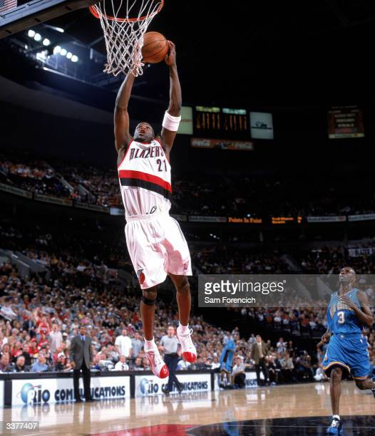 Ruben Patterson of the Portland Trail Blazers takes the ball to the basket during a game against the New Orleans Hornets at The Rose Garden on April...
