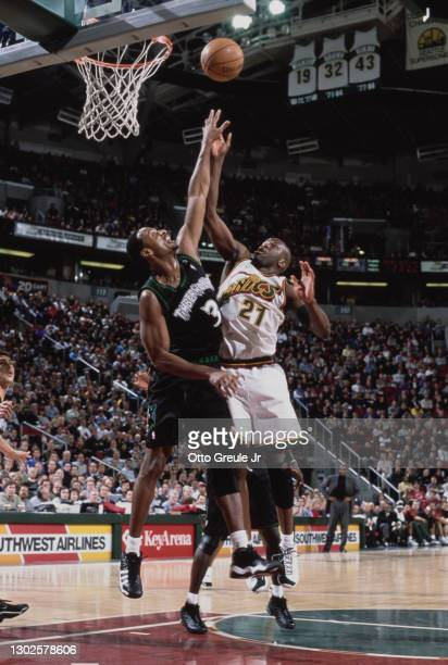 Ruben Patterson, Small Forward and Shooting Guard for the Seattle SuperSonics challenges LaPhonso Ellis of the Minnesota Timberwolves on the rebound...