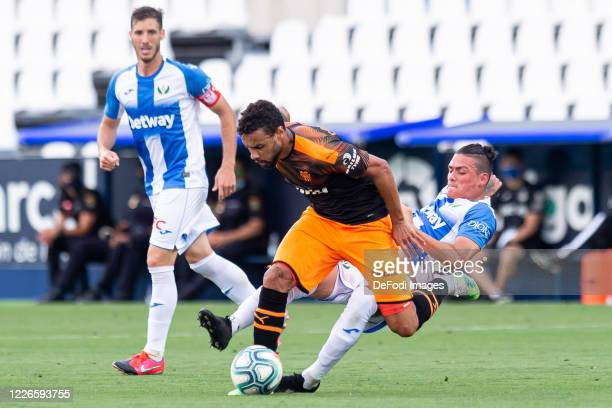 Ruben Perez J.i. Of CD Leganes, Francis Coquelin of Valencia CF and Jonathan Silva of CD Leganes battle for the ball during the Liga match between CD...