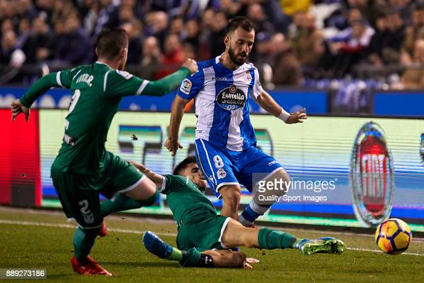 Ruben Perez of CD Leganes competes for the ball with Emre Çolak of Deportivo de La Coruna during the La Liga match between Deportivo La Coruna and...