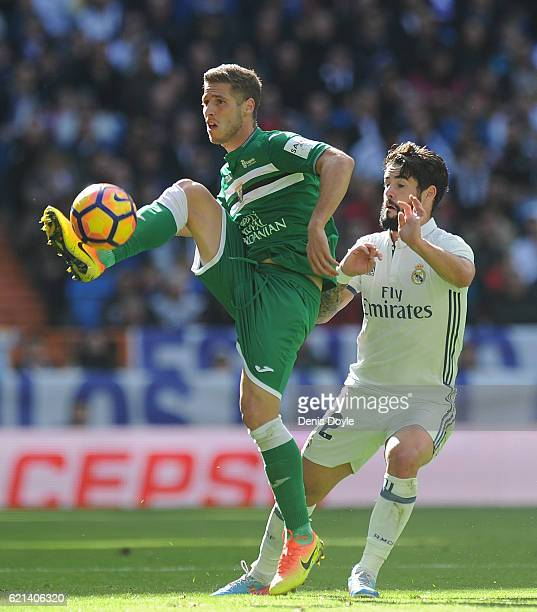 Ruben Perez of CD Leganes controls the ball while being challenged by Isco of Real Madrid during the Liga match between Real Madrid CF and Leganes on...