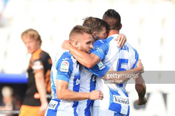 Ruben Perez of Leganes celebrates with teammates Kevin Rodrigues and Jonathan Silva of Leganes after scoring his team's first goal from the penalty...