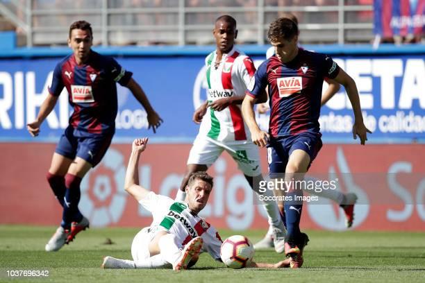 Ruben Perez of Leganes Pape Diop of SD Eibar during the La Liga Santander match between Eibar v Leganes at the Estadio Municipal de Ipurua on...