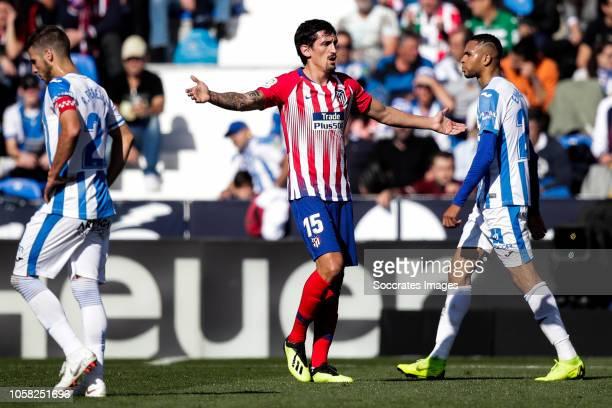 Ruben Perez of Leganes Savic of Atletico Madrid during the La Liga Santander match between Leganes v Atletico Madrid at the Estadio Municipal de...