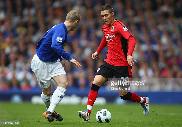 Ruben Rochina of Blackburn Rovers attempts to move past Tony Hibbert of Everton during the Barclays Premier League match between Everton and...