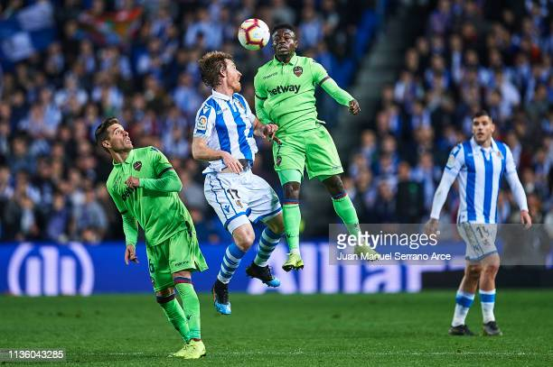 Ruben Rochina of Levante UD and Moses Simon of Levante UD competes for the ball with David Zurutuza of Real Sociedad during the La Liga match between...