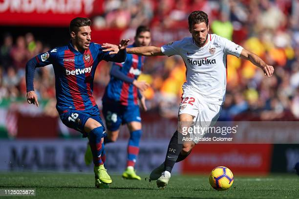Ruben Rochina of Levante UD competes for the ball with Franco Vazquez of Sevilla FC during the La Liga match between Sevilla FC and Levante UD at...