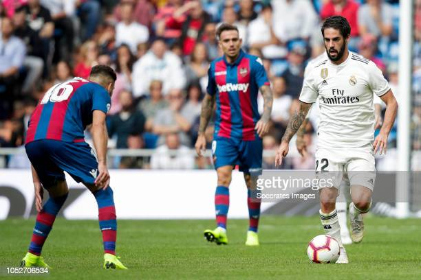 Ruben Rochina of Levante UD Roger Marti of Levante UD Isco of Real Madrid during the La Liga Santander match between Real Madrid v Levante at the...