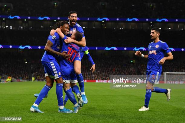 Ruben Semedo of Olympiacos celebrates with teammates after scoring his team's second goal during the UEFA Champions League group B match between...