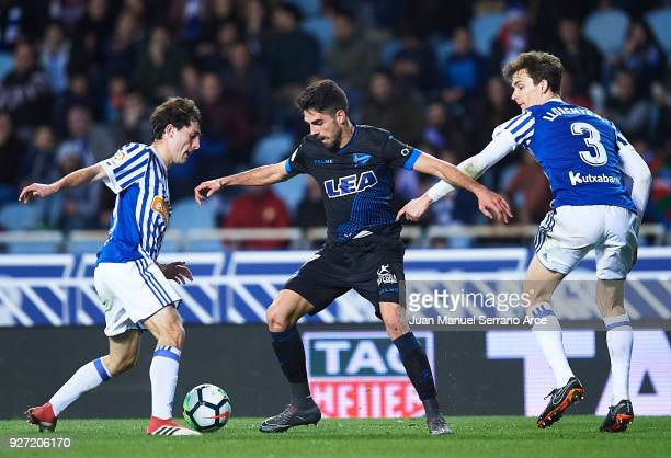 Ruben Sobrino of Deportivo Alaves being followed by Alvaro Odriozola and Diego Llorente of Real Sociedad during the La Liga match between Real...