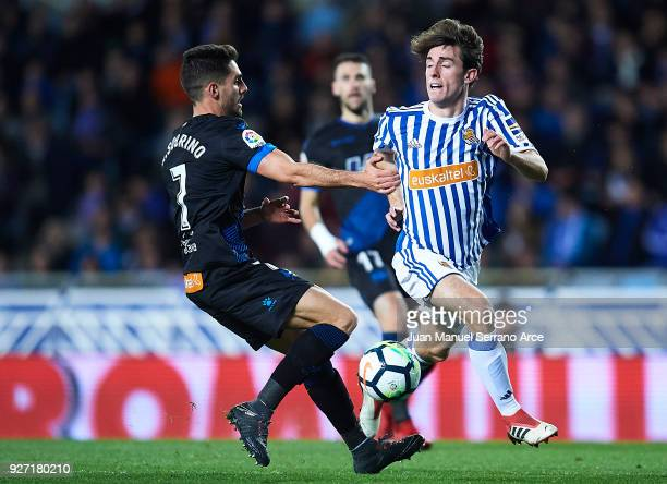 Ruben Sobrino of Deportivo Alaves competes for the ball with Alvaro Odriozola of Real Sociedad during the La Liga match between Real Sociedad and...