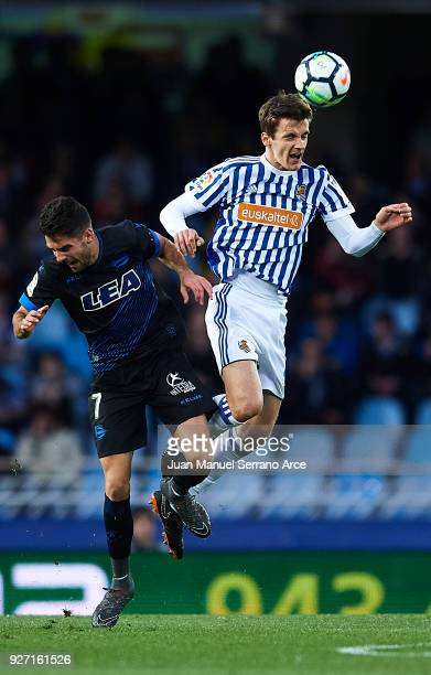 Ruben Sobrino of Deportivo Alaves competes for the ball with Diego Llorente of Real Sociedad during the La Liga match between Real Sociedad and...