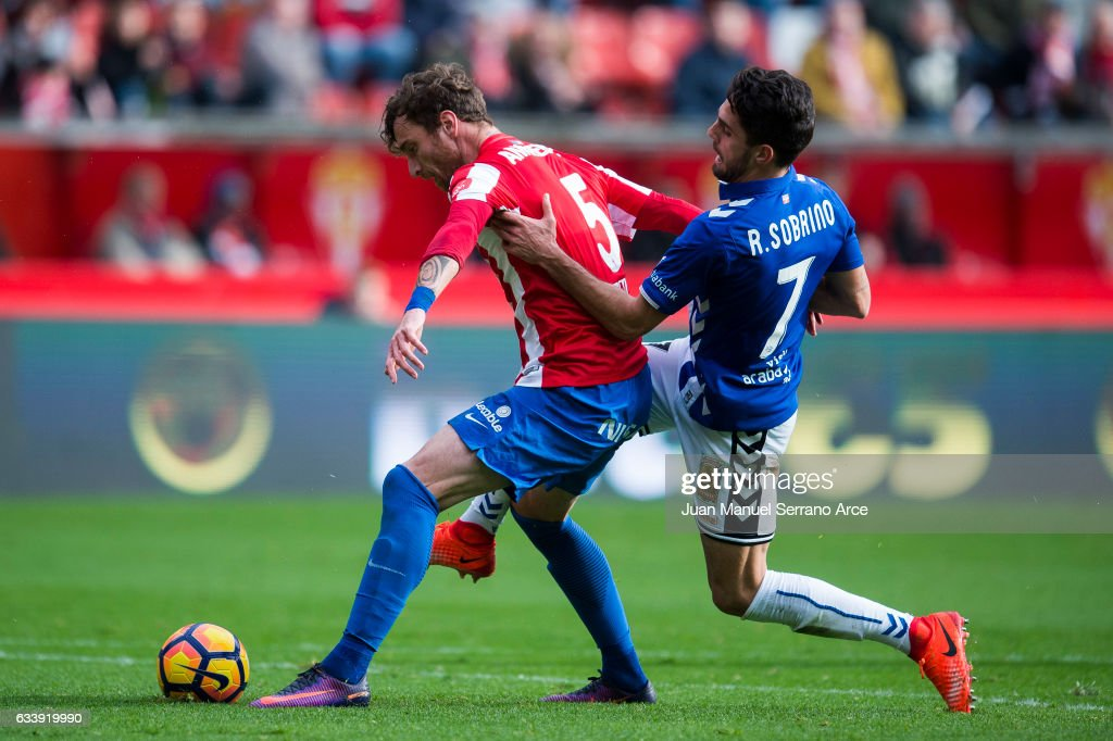 Ruben Sobrino of Deportivo Alaves duels for the ball with Fernando Amorebieta of Real Sporting de Gijon during the La Liga match between Real Sporting de Gijon and Deportivo Alaves at Estadio El Molinon on February 5, 2017 in Gijon, Spain.