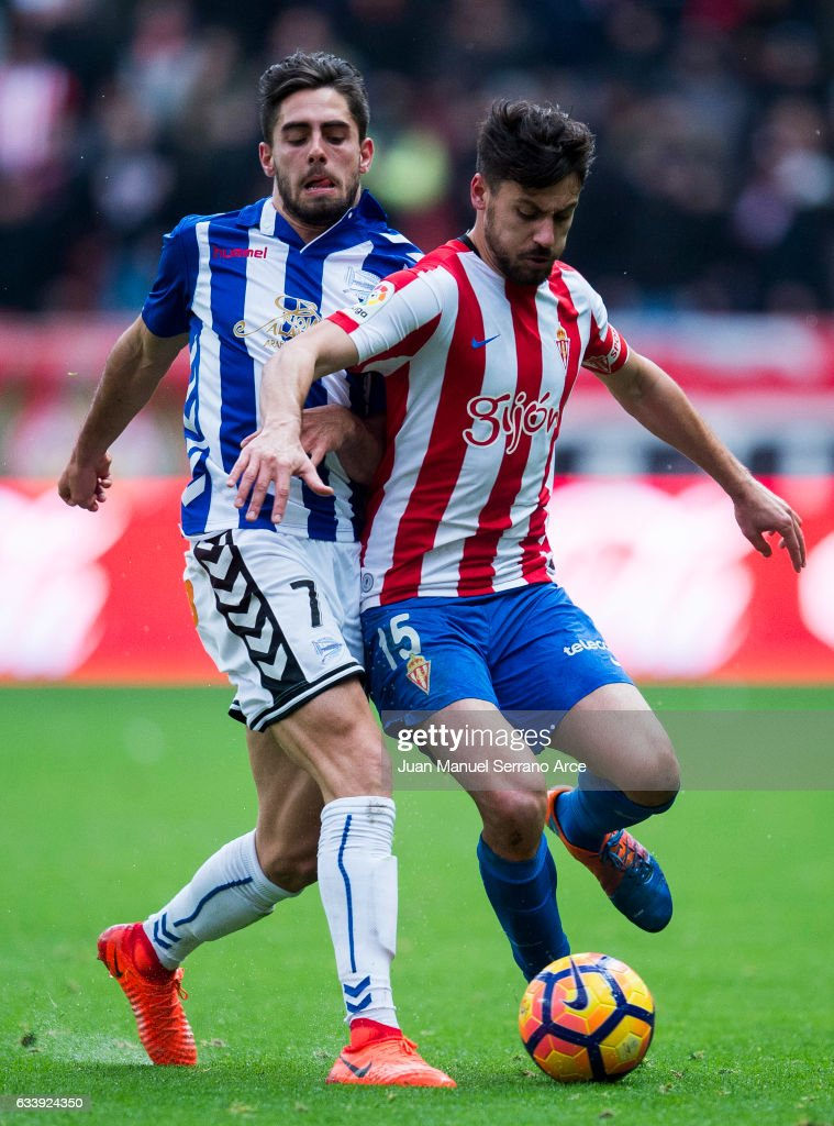 Ruben Sobrino of Deportivo Alaves duels for the ball with Roberto Canella of Real Sporting de Gijon during the La Liga match between Real Sporting de Gijon and Deportivo Alaves at Estadio El Molinon on February 5, 2017 in Gijon, Spain.