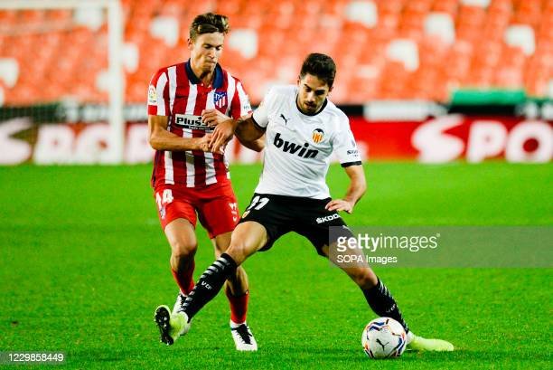 Ruben Sobrino of Valencia and Marcos Llorente of Atletico de Madrid in action during the Spanish La Liga football match between Valencia and Atletico...
