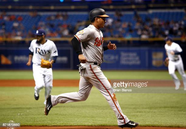 Ruben Tejada of the Baltimore Orioles runs in to score off of a tworun single by Manny Machado off of pitcher Sergio Romo of the Tampa Bay Rays...