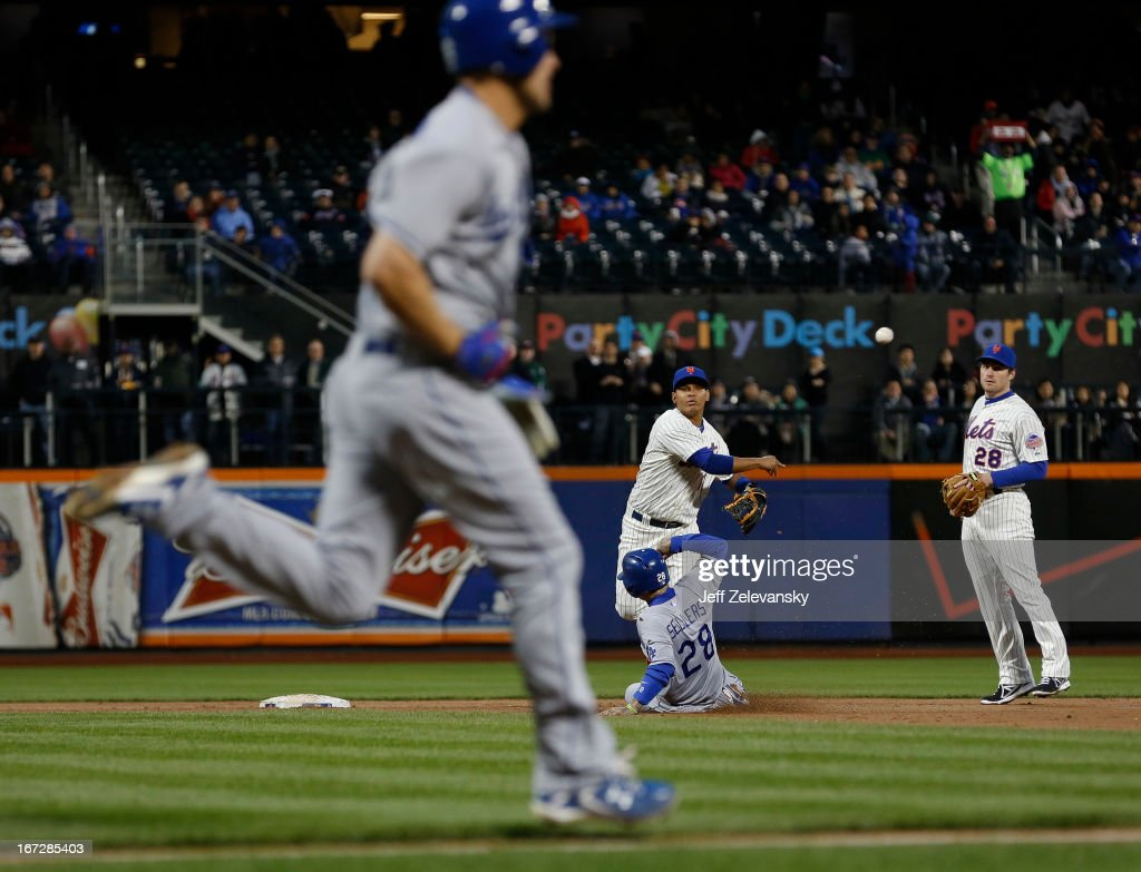 Ruben Tejada #11 of the New York Mets forces Justin Sellers #28 of the Los Angeles Dodgers and throws to first to complete a double play on Clayton Kershaw #22 of the Los Angeles Dodgers in the second inning at Citi Field in the Flushing neighborhood of the Queens borough of New York City.