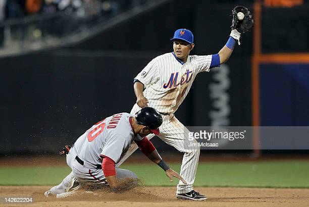 Ruben Tejada of the New York Mets holds the ball after forcing out Ian Desmond of the Washington Nationals to end the top of the ninth inning at Citi...