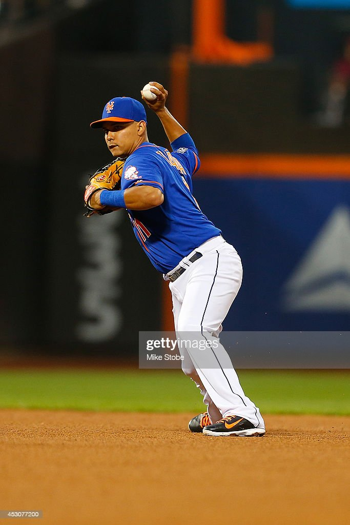 Ruben Tejada #11 of the New York Mets in action against the San Francisco Giants at Citi Field on August 1, 2014 in the Flushing neighborhood of the Queens borough of New York City. Giants defeated the Mets 5-1.