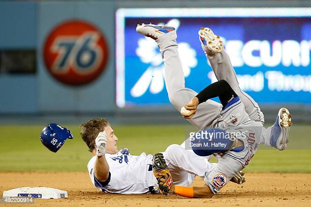Ruben Tejada of the New York Mets is hit by a slide by Chase Utley of the Los Angeles Dodgers in the seventh inning in an attempt to turn a double...