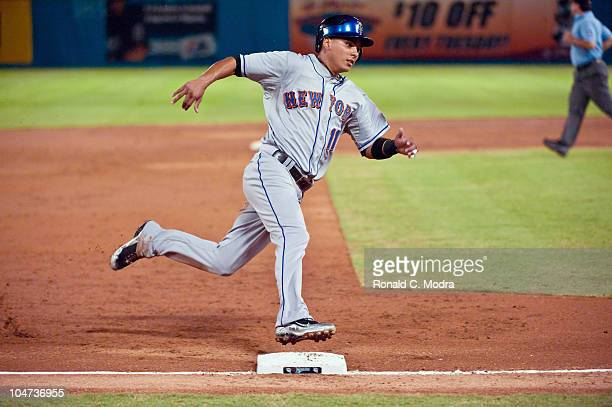 Ruben Tejada of the New York Mets runs to third base during a MLB game against the Florida Marlins at Sun Life Stadium on September 22 2010 in Miami...