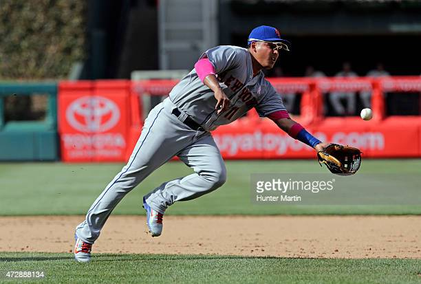 Ruben Tejada of the New York Mets shovels the ball to first base after fielding a ground ball in the ninth inning during a game against the...
