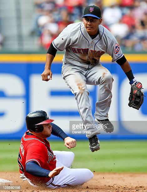 Ruben Tejada of the New York Mets throws past Freddie Freeman of the Atlanta Braves for a double play in the fifth inning of the game at Turner Field...