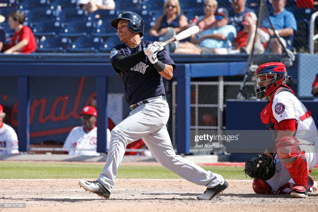 Ruben Tejada #30 of the New York Yankees singles against the Washington Nationals in the eighth inning during a spring training game at The Ballpark of the Palm Beaches on March 20, 2017 in West Palm Beach, Florida. The Yankees defeated the Nationals 9-3.