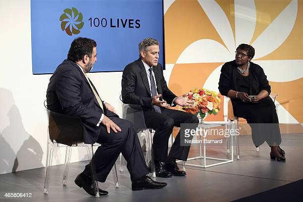 Ruben Vardanian George Clooney and Gwen Ifill speak onstage at The 100 LIVES initiative to express gratitude to the individuals and institutions...