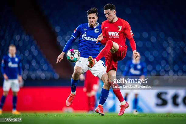 Ruben Vargas of Augsburg and Suat Serdar of Schalke in action during the Bundesliga match between FC Schalke 04 and FC Augsburg at Veltins-Arena on...
