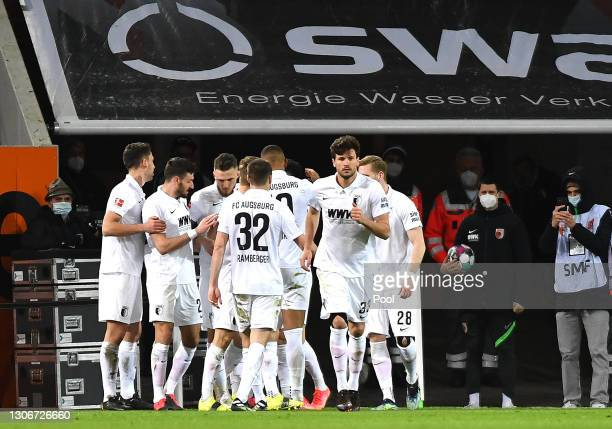 Ruben Vargas of Augsburg celebrates with teammates after scoring their team's first goal during the Bundesliga match between FC Augsburg and Borussia...