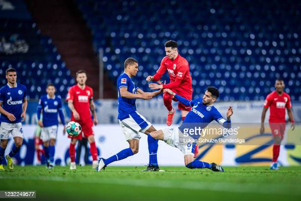 Ruben Vargas of Augsburg in action against Omar Mascarell and Malick Thiaw of Schalke during the Bundesliga match between FC Schalke 04 and FC...