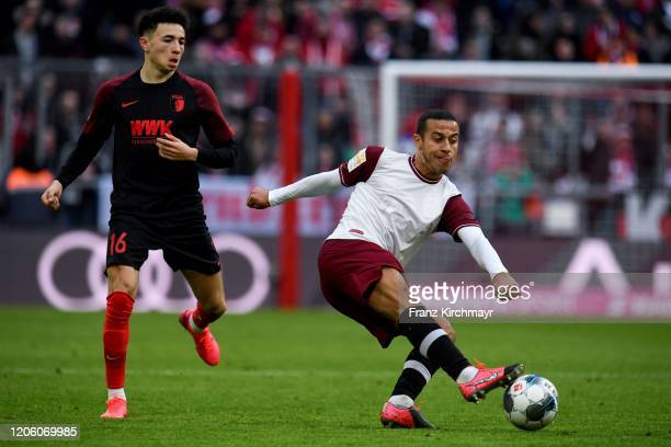 Ruben Vargas of FC Augsburg and Thiago Alcantara Nascimiento of Bayern Muenchen during the Bundesliga match between FC Bayern Muenchen and FC...