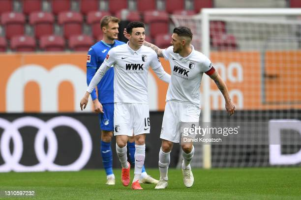 Ruben Vargas of FC Augsburg celebrates with team mate Jeffrey Gouweleeuw after scoring their side's first goal during the Bundesliga match between FC...