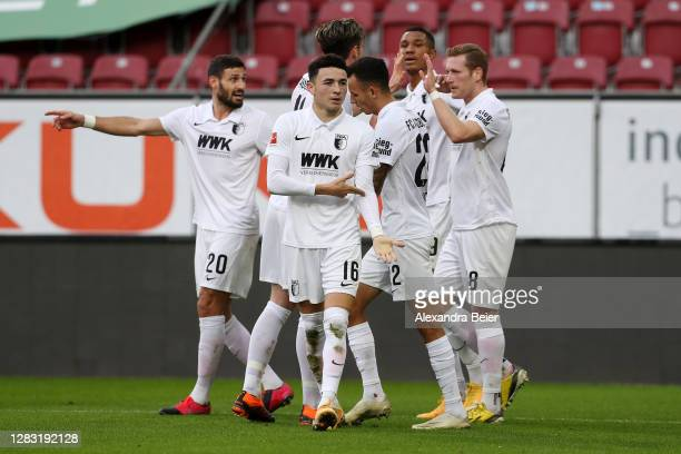 Ruben Vargas of FC Augsburg celebrates with teammates after scoring his team's first goal during the Bundesliga match between FC Augsburg and 1. FSV...