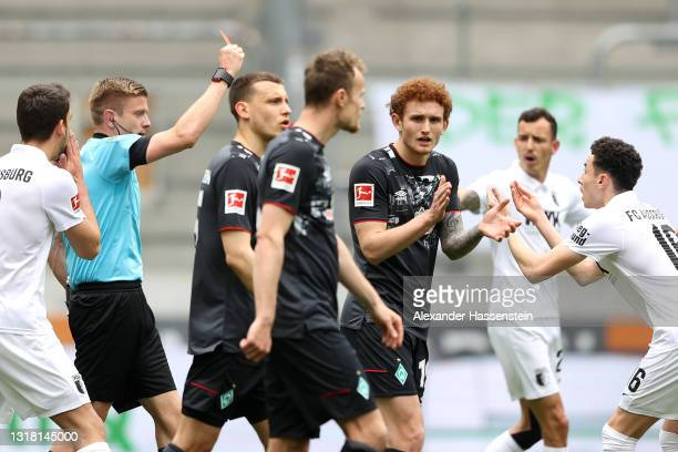 Ruben Vargas of FC Augsburg is shown a red card during the Bundesliga match between FC Augsburg and SV Werder Bremen at WWK-Arena on May 15, 2021 in...