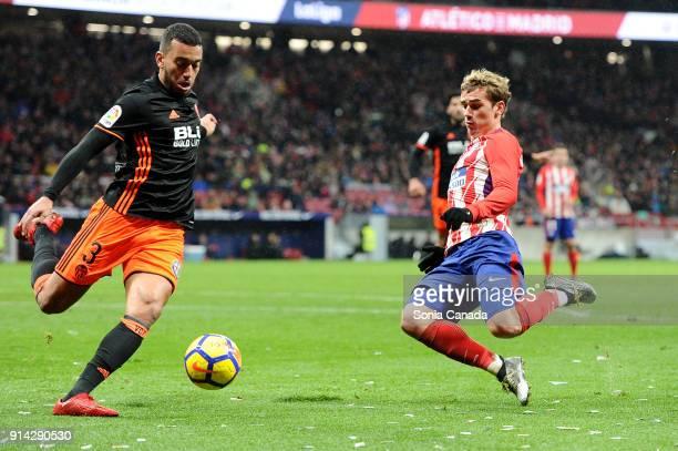Ruben Vezo #3 of Valencia CF and Antoine Griezmann #7 of Atletico de Madrid during the La Liga match between Club Atletico de Madrid and Valencia at...
