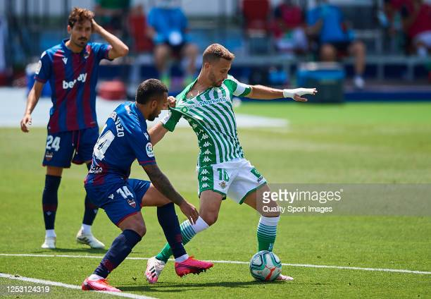 Ruben Vezo of Levante UD competes for the ball with Sergio Canales of Real Betis Balompie during the Liga match between Levante UD and Real Betis...