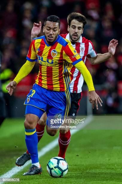 Ruben Vezo of Valencia CF Enric Saborit of Athletic Bilbao during the La Liga Santander match between Athletic de Bilbao v Valencia at the Estadio...