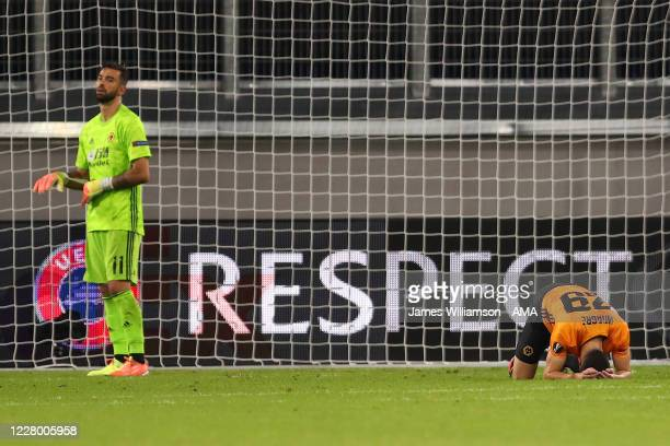 Ruben Vinagre and Rui Patricio of Wolverhampton Wanderers look dejected at the end of the UEFA Europa League Quarter Final between Wolves and Sevilla...