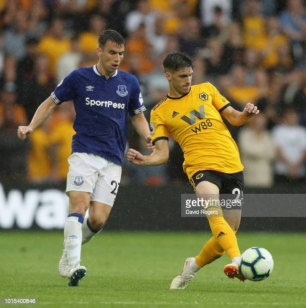 Ruben Vinagre of Wolverhampton Wanderers passes the ball as Seamus Coleman challenges during the Premier League match between Wolverhampton Wanderers...
