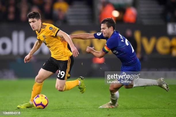 Ruben Vinagre of Wolverhampton Wanderers runs past Cesar Azpilicueta of Chelsea during the Premier League match between Wolverhampton Wanderers and...