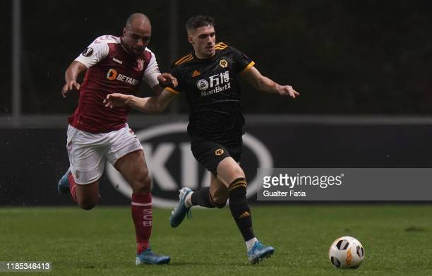 Ruben Vinagre of Wolverhampton Wanderers with Wilson Eduardo of SC Braga in action during the Group K UEFA Europa League match between SC Braga and...