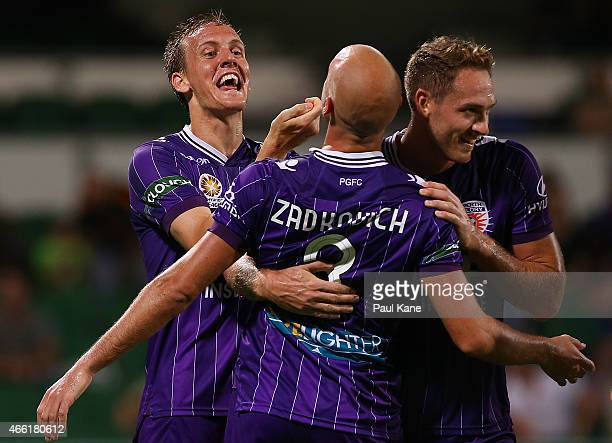 Ruben Zadkovich of the Glory is congratulated by Michael Thwaite and Rostyn Griffiths after scoring an equalising goal during the round 21 ALeague...