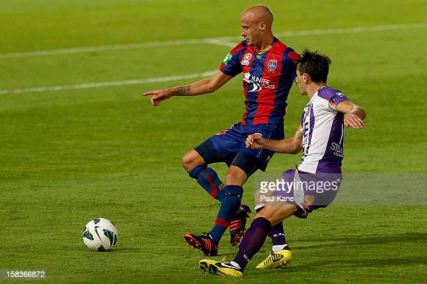 Ruben Zadkovich of the Jets and Liam Miller of the Glory contest the ball during the round 11 ALeague match between the Perth Glory and the Newcastle...