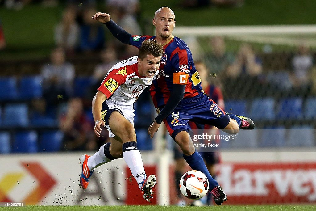 Ruben Zadkovich of the Jets contests the ball against Nathan Konstandopoulos of Adelaide United during the round 27 A-League match between the Newcastle Jets and Adelaide United at Hunter Stadium on April 11, 2014 in Newcastle, Australia.
