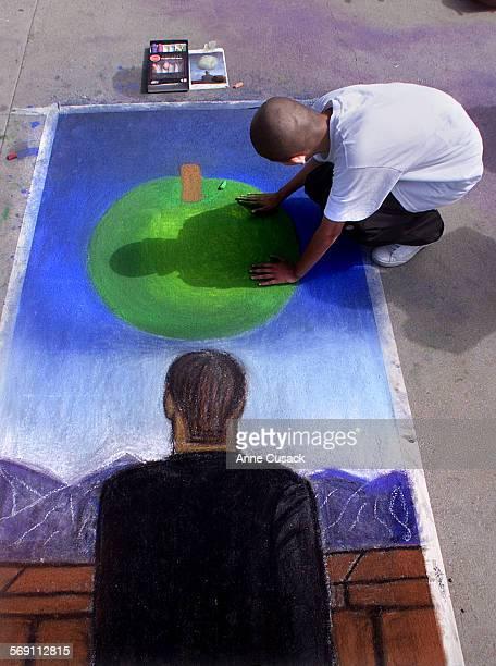 Ruben Zaragoza age 15 a junior at Buena High School in Ventura wipes the apple in their replica of 'La Carte Postale' by Rene Magritte In celebration...