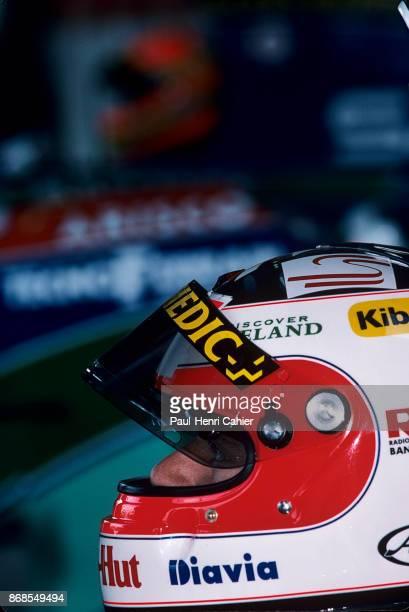 Rubens Barrichello, Eddie Irvine, Jordan-Hart 194, Grand Prix of Great Britain, Silverstone Circuit, 10 July 1994. Rubens Barrichello and his Jordan...
