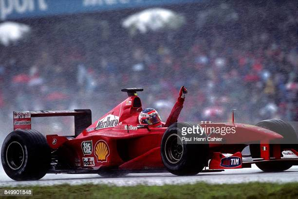 Rubens Barrichello, Ferrari F1-2000, Grand Prix of Germany, Hockenheimring, Hockenheim, Germany, July 30, 2000. Rubens Barrichello raises his hand...