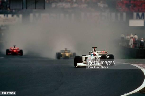 Rubens Barrichello, Heinz-Harald Frentzen, Michael Schumacher, Stewart-Ford SF3, Jordan-Mugen-Honda 199, Ferrari F199, Grand Prix of France, Circuit...